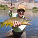 Man Fly Fishing Catches Trout